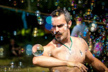 Contact juggling and bubbles. Copyright Sandy McClure